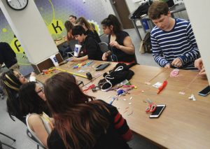 Teens made rainbow bracelets to be distributed and worn during LGBTQ+ Pride month.